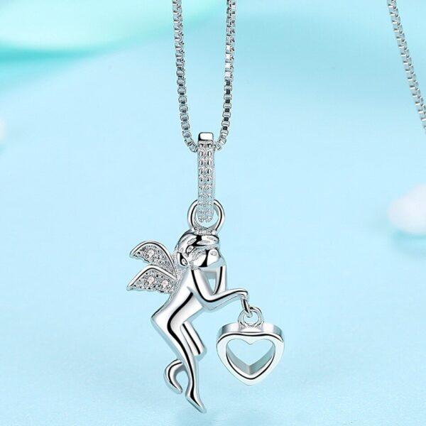 pendentif ange en argent avec coeur 01